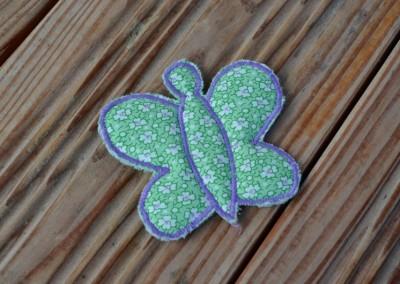 Barrette papillon vert